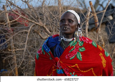 NGORONGORO CONSERVATION AREA, TANZANIA - JANUARY 24: Unidentified African woman from Masai tribe on January 24, 2008. Old woman in a traditional African dress and decorations.