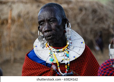 NGORONGORO CONSERVATION AREA, TANZANIA - JANUARY 24: Unidentified African woman from Masai tribe on January 24, 2008. Old woman in a traditional African dress and decorations. .