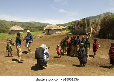 Ngorongoro Conservation Area, Tanzania - March 8, 2017 : Tourists photographing childern in Maasai village in Ngorongoro Conservation Area, Tanzania, Africa.