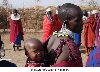 Ngorongoro, Tanzania - August, 08, 2007: Very young child is on the back of his mother