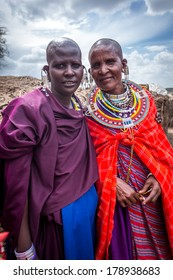 NGORONGORO, TANZANIA - December 29, 2013 : The Masia women smiling with welcome for the tourists who visit Masai village