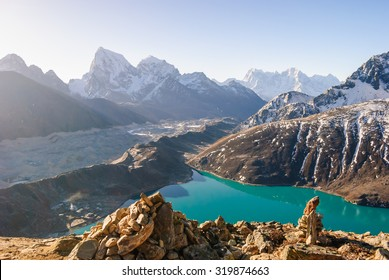 Ngozumpa Glacier flowing down from the high snow capped mountains of the Himalayas. View from Gokyo Ri, 5360 meters up in the Himalaya Mountains of Nepal