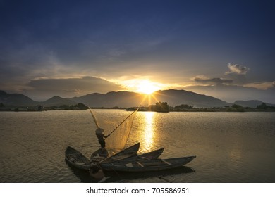 Nha Trang city, Khanh Hoa province, Vietnam - August 12, 2017:  Landscape beautiful. Shadow fishermen at river in the sunset.