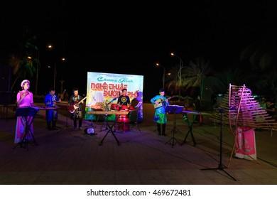 Nha Trang city, Viet Nam - July 31, 2016 : Vietnamese traditional folk band perform on street at night in Nha Trang city