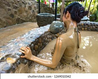 Nha Trang, Khánh Hòa Province, Vietnam - October 26, 2018: Female Tourist Experiencing Mud Bath at 100 Egg Theme Park