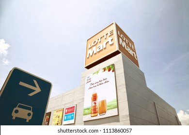 Nha Trang, Vietnam - April 1, 2018: Korean famous supermarket Lotte Mart building facade. Storefront of a big shopping mall with a logo sign and advertisement banners on the walls. Text: Herbal drink