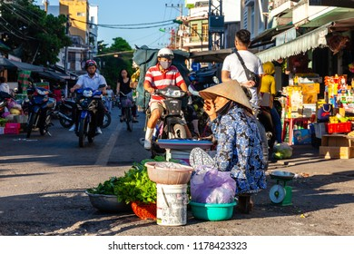 NHA TRANG, VIETNAM - AUGUST 06: A senior woman sells greenery at the street market on August 06, 2018 in Nha Trang, Vietnam.