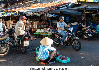 NHA TRANG, VIETNAM - AUGUST 06: A woman sells dried fish at the street market on August 06, 2018 in Nha Trang, Vietnam.