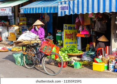 NHA TRANG, VIETNAM - DECEMBER 18: Vietnamese women in the traditional conical hat at the wet market on December 18, 2015 in Nha Trang, Vietnam.