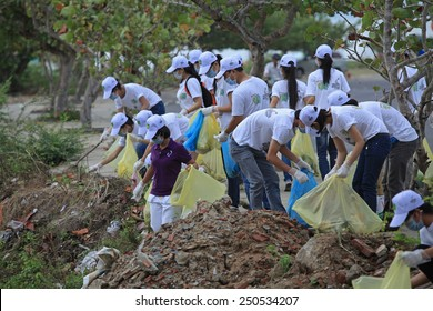 NHA TRANG, VIETNAM - JUNE 16, 2013: Students of Nha Trang University cleaning the beach within a volunteer event for environment saving. Nha Trang is one of the world most beautiful beaches.