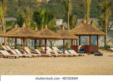 Nha Trang, Vietnam - May 15 2016 : Sunbeds and umbrellas on the beach of Nha Trang, Vietnam