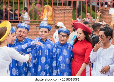 Nha Trang, Vietnam - May 5, 2018: men and women in traditional Vietnamese costumes at Po Nagar Temple celebration (Le hoi Thap Ba Ponagar).