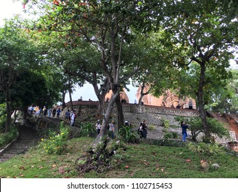 NHA TRANG, VIETNAM - OCTOBER 2017: Tourists stroll around at the Ponagar Cham temple tower of the 8th century