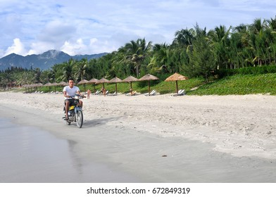 Nha Trang, VIETNAM -OCTOBER 4 ,2013:A man rides a scooter on the beach, Doc let