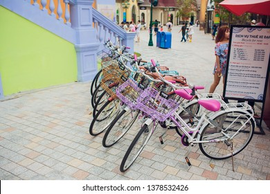 NHA TRANG,VIETNAM - FEBRUARY 17,2018: Row of bicycle style classic with seats at sidewalk parking.