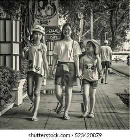 NHA-TRANG, VIETNAM - APRIL of 2016: Three young ladies on a street