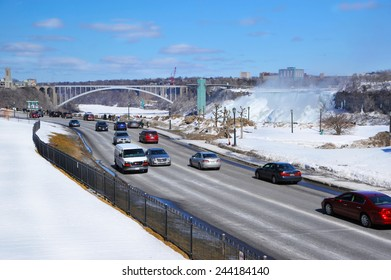 NIAGARA, CANADA - 16 MARCH: Highway alongside the Falls on the Canadian side with US Falls in the background taken on March 16, 2014 in Niagara, Ontario in Canada.