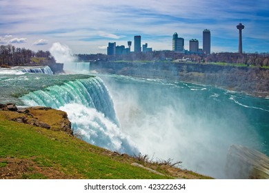 Niagara Falls from American side and Skyscrapers from Canadian side. A view on American Falls, Bridal Veil Falls, Goat Island, Horseshoe falls and Canada Skyscrapers on the background.