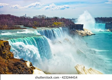 Niagara Falls from the American side in spring. A view from Niagara State Park on American Falls, Bridal Veil Falls, Goat Island and Horseshoe falls on the background.