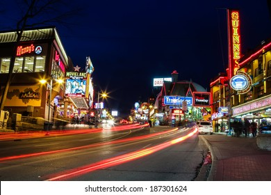 NIAGARA FALLS, CANADA - 12TH APRIL 2014: Part of the  Centre Street in Niagara Falls at night where many entertainment attractions as well as the blur of people and traffic