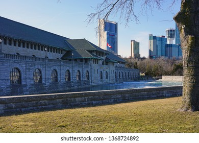 NIAGARA FALLS, CANADA -27 MAR 2019- View of the Canadian Power Niagara building on the waterfront on the Niagara River in Niagara Falls, Ontario, Canada.