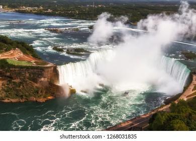 Niagara Falls, Canada. Aerial panoramic view of Niagara Horseshoe Falls, the Canadian side of Niagara Falls, boats and upper Niagara river.
