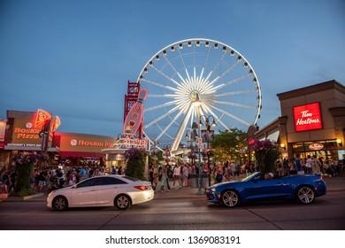 NIAGARA FALLS, CANADA - JULY 23, 2016: Niagara Falls city and street at night, Niagara city has many business and entertainments options design for tourism.