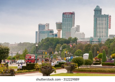 NIAGARA FALLS, CANADA - JULY 23, 2008: Buildings over the falls. The attraction welcomes more than 12 million visitors annually.