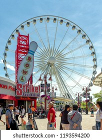 "Niagara Falls, Canada - June 15, 2018: View of Clifton Hill, known as the "" Street of Fun"", one of the major tourist promenades in Niagara Falls, Ontario."