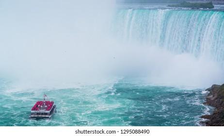 Niagara falls, Canada - June 27 2018: Tourism boat sailing in the Niagara Falls lake