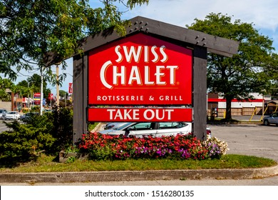 Niagara Falls, Canada - September 18, 2019: Sign of Swiss Chalet restaurant in Niagara Falls, Canada. Swiss Chalet is a Canadian chain of casual dining restaurants founded in 1954 in Toronto, Ontario.