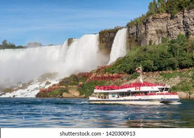 Niagara Falls, Canada - September 25, 2016: Boat Hornblower with tourists at the bottom of Horseshoe waterfall. Niagara Falls, Canada.