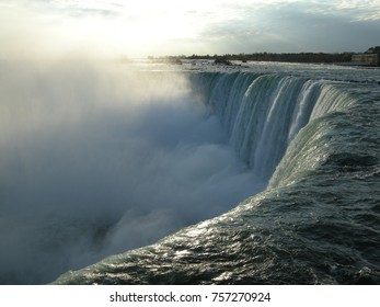 Niagara Falls, Canada side. Close up of the waters in movement. Dynamic textures of waters rumble against rising cloud of vapours in the background, creating a dramatic backdrop.
