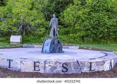 NIAGARA FALLS - JUNE 14 2016: The statue of Nikola Tesla, a Serbian American inventor, electrical & mechanical engineer, physicist and futurist.