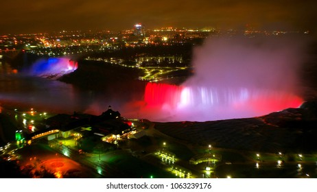 Niagara Falls with light of USA and Canada's flag in the night