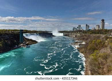 Niagara Falls, New York - May 8, 2016: The American Falls at Niagara Falls, New York viewed from the Rainbow Bridge.