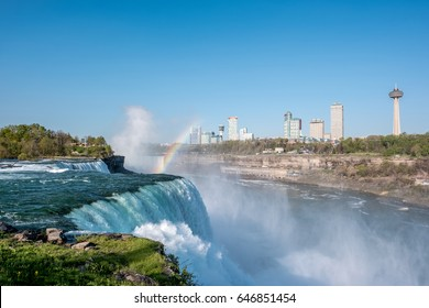 NIAGARA FALLS, NEW YORK, USA - MAY 20: American side of Niagara Falls waterfall with rainbow, view of Canadian side from New York state, USA