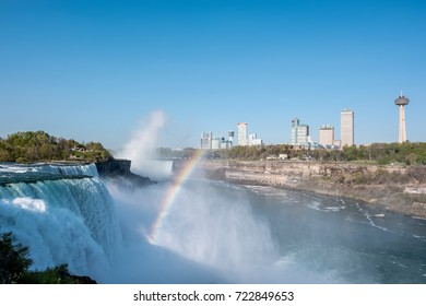 NIAGARA FALLS, NEW YORK, USA - MAY 20, 2017: American side of Niagara Falls waterfall with rainbow, view of Canadian side from New York state, USA