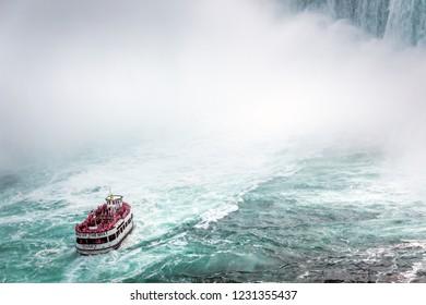 Niagara Falls - OCTOBER 06, 2018: The Maid of the Mist boat near waterfall at Niagara falls, Canada.