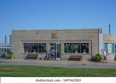 Niagara Falls, Ontario / Canada - August 14, 2019: Tourists visit the Niagara Parks Welcome Centre in the old Niagara Parks Commission building, on Niagara Parkway.