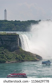 Niagara Falls, Ontario, Canada - July 4, 2018:  View from Canadian side of the Horseshoe Falls in summer and tour boats Maid of the Mist and Hornblower on the Niagara River, vertical orientation.
