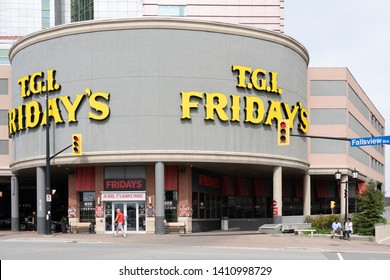 Niagara falls, Ontario, Canada - May 27, 2019: Entrance of T.G.I Fridays in Niagara falls, Ontario, Canada. TGI Fridays is an American restaurant chain focusing on casual dining.