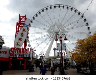 Niagara Falls, Ontario, Canada, Oct. 13, 2018: The Sky Wheel and Strike! Rock and Bowl attractions are seen at the Great Canadian Midway at Clifton Hill are seen.