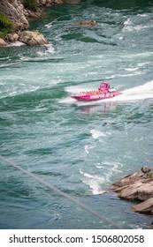 Niagara Falls, Ontario Canada - September 17, 2018 : A 'Whirlpool Jet Boat Tours' boat racing down the Niagara River.