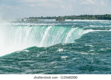 Niagara Falls, Ontario, Canada.  View of Canadian Horseshoe Falls from upstream in summer.