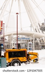 Niagara Falls, Ontario - January 20, 2019 : Snow is plowed from the streets and walkways in front of the Niagara SkyWheel after a winter storm dumps heavy snow in Niagara Falls, Ontario.