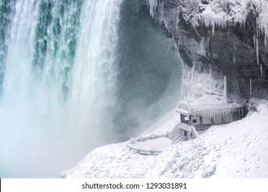 Niagara Falls, Ontario - January 20, 2019 - Niagara looking frozen as a winter storm hit the area with snow and freezing temperatures. Journey Behind The Falls Viewing Platform beneath Horseshoe Falls
