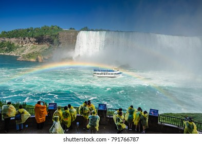 NIAGARA FALLS, ONTARIO - JUNE 2016: Tourists and visitors experience the natural wonder that is Niagara Falls. Journey Behind the Falls, Ontario, Canada