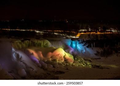 Niagara Falls under the night lights in winter - frozen.