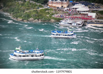 Niagara Falls, USA – August 29, 2018: American and Canadian ferry with tourists of the boat in tour Horseshoe waterfall Niagara Falls